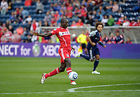 Chicago forward Dominic Oduro (8) knocks the ball away from oncoming New England goalkeeper Matt Reis (1, not pictured).  Oduro would recover the ball and score on the play.  The Chicago Fire defeated the New England Revolution 3-2 at Toyota Park in Bridgeview, IL on Sept. 25, 2011.