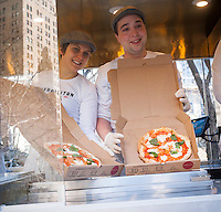 The new Neapolitan Express pizza food truck debuts in the City Hall Park in New York on Thursday, February 21, 2013. The truck is the first to run 100 percent on compressed natural gas, both preparation and engine operation, in a partnership with Clean Energy Fuels. The debut of the truck was hosted by New York Mayor Michael Bloomberg and energy executive T. Boone Pickens. (© Richard B. Levine)