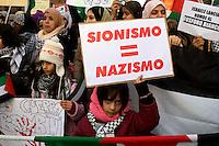 Roma 17 Gennaio 2009.Manifestazione  Contro l'attacco di Israele alla striscia di Gaza..Demonstration against the attack of Israel to the Gaza Strip.The banner reads: .Zionism = Nazism.