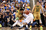 13 March 2015: Duke's Justise Winslow (12) is guarded by Notre Dame's Jerian Grant (22). The Notre Dame Fighting Irish played the Duke University Blue Devils in an NCAA Division I Men's basketball game at the Greensboro Coliseum in Greensboro, North Carolina in the ACC Men's Basketball Tournament semifinal game. Notre Dame won the game 74-64.