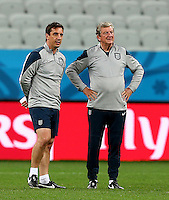 England manager Roy Hodgson and coach Gary Neville during training ahead of their Group D fixture vs Uruguay tomorrow