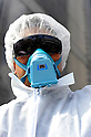 Tokyo, Japan - March 11: A man with a mask and suit for nuclear decontamination participated in a demonstration against nuclear power plants in front of Tokyo Electric Power Company at Chiyoda, Tokyo, Japan on March 11, 2012. As this day was one year anniversary of Great East Japan Earthquake and Tsunami, there were many demonstrations held in the city.