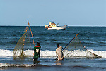Fishers pulling in a fine mesh gill net along the Malindi coastline, Kenya