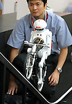 "Murata Manufacturing Co.'s ""Murata Boy,"" a cycing humanoid robot, is shown at a toy show in Japan."