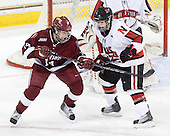 Jillian Dempsey (Harvard - 14), Lori Antflick (NU - 77) - The Harvard University Crimson defeated the Northeastern University Huskies 4-3 (SO) in the opening round of the Beanpot on Tuesday, February 8, 2011, at Conte Forum in Chestnut Hill, Massachusetts.