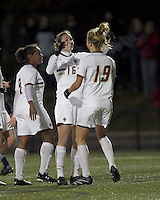 """Boston College forward Brooke Knowlton (16) celebrates her goal with teammates. Boston College defeated West Virginia, 4-0, in NCAA tournament """"Sweet 16"""" match at Newton Soccer Field, Newton, MA."""