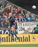 New England Revolution midfielder Monsef Zerka (19) heads the ball. In a Major League Soccer (MLS) match, the Seattle Sounders FC defeated the New England Revolution, 2-1, at Gillette Stadium on October 1, 2011.
