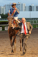 HALLANDALE BEACH, FL - MARCH 04:  Gunnevera (KY) with jockey Javier Castellano  and owner, Salomon Del Valle, celebrate as they head to the winners circle after winning the $400,000 Xpressbet Fountain Of Youth Stakes (Grade II) at Gulfstream Park on March 04, 2017 in Hallandale Beach, Florida. (Photo by Liz Lamont/Eclipse Sportswire/Getty Images)