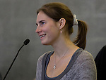 Amanda Knox smiles while talking during a news conference held  at the Seattle-Tacoma International Airport near Seattle, Washington on October 4, 2011. Knox arrived in the United States after departing Rome's Leonardo da Vinci airport,. Knox's life turned around dramatically Monday when an Italian appeals court threw out her conviction in the sexual assault and fatal stabbing of her British roommate.  ©2011. Jim Bryant Photo. All Rights Reserved.