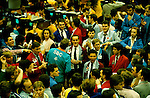 LIFFE, London International Financial Futures Exchange. This  was all pre-computer trading, and is where deals were struck, Derivatives, Options and Futures were bought and sold by shouting across the trading floor know at the 'Bear Pit' and frantic gesturing. They wore different coloured jackets so that colleagues could pick each other out in the frenzy of a days work.