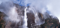 793050060 the top of angel falls the tallest waterfall in the world and auyan tepui rise above the clouds in the lost world area of canaima national park in venezuela one of the most remote places on earth