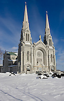 Exterior view of the Basilique Sanctuaire Sainte-Anne-de-Beaupre Shrine, east of Quebec City. The Basilica of Sainte-Anne-de-Beaupre has been credited by the Catholic Church with many miracles of curing the sick and disabled. It is an important Catholic sanctuary which receives about a half-million pilgrims each year.