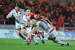 Regan King gets tackled by Thomas O'Leary and Ronan O'Gara (Capt). Scarlets V Munster, Magners League © © Ian Cook IJC Photography iancook@ijcphotography.co.uk www.ijcphotography.co.uk