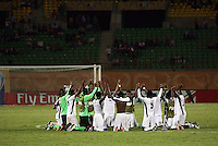 Ghana's team celebrates together on the field after beating South Korea during the FIFA Under 20 World Cup Quarter-final match between Ghana and South Korea at the Mubarak Stadium  in Suez, Egypt, on October 09, 2009.