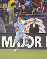 Sporting Kansas City defender Roger Espinoza (15) traps the ball. In a Major League Soccer (MLS) match, the New England Revolution defeated Sporting Kansas City, 3-2, at Gillette Stadium on April 23, 2011.