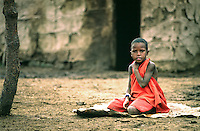 Young Maasai boy sitting quietly on a cattle skin. The Maasai are the people of myth and legend in East Africa--The warring pastoralist of days past who have adapted and survived in a changing environment both physically and politically.