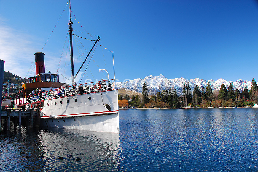 The Earnslaw Steamer Ship docked at Steamer Wharf. The Remarkables in the background, Queenstown, New Zealand
