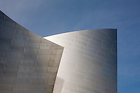 Blue Sky and Abstract detail of sculptural stainless steel forms of the facade of the Walt Disney Concert Hall, Los Angeles