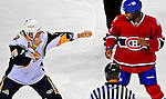 20 December 2008: Buffalo Sabres' left wing forward Andrew Peters picks a fight with Montreal Canadiens' right wing forward Georges Laraque in the first period at the Bell Centre in Montreal, Quebec, Canada. With both teams coming off wins, the Canadiens extended their winning streak by defeating the Sabres 4-3 in overtime. ***** Editorial Sales Only ***** Mandatory Photo Credit: Ed Wolfstein Photo