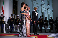US President Barack Obama (R) and First Lady Michelle Obama (2L) greet Italian Prime Minister Matteo Renzi (2R) and Italian First Lady Agnese Landini (L) on the North Portico of the White House in Washington DC, USA, 18 October 2016. President Obama and First Lady Michelle Obama are hosting their final state dinner featuring celebrity chef Mario Batali and singer Gwen Stefani performing after dinner. <br /> Credit: Shawn Thew / Pool via CNP / MediaPunch