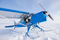 Super cub bush plane on zastrugi, wind blown snow, Seward Peninsula, Alaska.