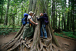 Kirsten and Brad hug an ancient old-growth tree at Cathedral Grove on Vancouver Island for the film, Branche Arbre. Production stills photo assignment for Red Letter Films.
