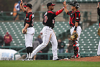 Left fielder Adam Walker (30), Juan Centeno (59), and J.R. Graham (39) of the Rochester Red Wings celebrate their win against the Scranton Wilkes-Barre Railriders on May 1, 2016 at Frontier Field in Rochester, New York. Red Wings won 1-0.  (Christopher Cecere/Four Seam Images)
