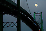 Mar 20, 2008- San Pedro, CA, USA The Moon rises over the Vincent Thomas Bridge in San Pedro.The bridge opened in 1963 and is a 1,500-foot long suspension bridge crossing the Los Angeles Harbor in California, linking San Pedro with Terminal Island.  It is named after former California Assemblyman Vincent Thomas of San Pedro. =