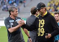 FUSSBALL   DFB POKAL 1. RUNDE   SAISON 2013/2014 TSV 1860 Muenchen - Borussia Dortmund         24.09.2013 Shake Hands, Trainer Juergen Klopp (re, Borussia Dortmund) und Trainer Friedhelm Funkel (1860 Muenchen)