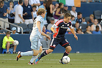 Kelyn Rowe (11) midfield New England Revolution in action..Sporting Kansas City and New England Revolution played to a 0-0 tie at LIVESTRONG Sporting Park, Kansas City, KS.