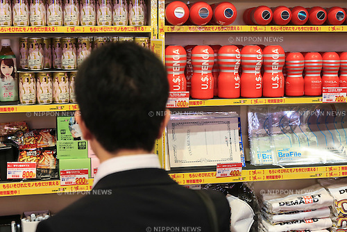A visitor looks at various adult products on display during the first day of the Japan Adult Expo 2015 on November 17, 2015, Tokyo, Japan. 69 film production companies, novelty goods makers and over a hundred AV actresses will attend the second annual two day expo in Toyosu Pit from November 17 to 18. Organizers aim to give fans the opportunity to meet their idols. (Photo by Rodrigo Reyes Marin/AFLO)