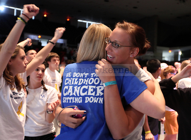 Communication Sophomore Liz Pawley hugs fellow Alpha Theta sister LeighAnn Renfro at the Dance Blue dance marathon for children with cancer on Saturday, Feb. 19, 2011.  Photo by Britney McIntosh   Staff