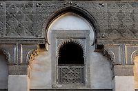 Detail of first floor window overlooking central courtyard, Sahrij Medersa, (Medersa des Andalous), 1321, Fez, Medersa Sahrij, Fez, Morocco, pictured on February 23, 2009 in the morning. The Sahrij Medersa takes its name from the pool in its courtyard, (sahrij means basin). Green and white minarets crown the theological school founded by Merinid sultan Abou al-Hassan and attached to the Al-Andalous mosque.  It is decorated with ornate  dark cedar panels (mashrabiya), decorated tiles (zellij), marble pavings and intricate plasterwork. Fez, Morocco's second largest city, and one of the four imperial cities, was founded in 789 by Idris I on the banks of the River Fez. The oldest university in the world is here and the city is still the Moroccan cultural and spiritual centre. Fez has three sectors: the oldest part, the walled city of Fes-el-Bali, houses Morocco's largest medina and is a UNESCO World Heritage Site;  Fes-el-Jedid was founded in 1244 as a new capital by the Merenid dynasty, and contains the Mellah, or Jewish quarter; Ville Nouvelle was built by the French who took over most of Morocco in 1912 and transferred the capital to Rabat. Picture by Manuel Cohen.