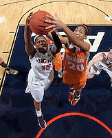 CHARLOTTESVILLE, VA- NOVEMBER 20: Ariana Moorer #15 of the Virginia Cavaliers fights for the rebound with Isabelle Harrison #20 of the Tennessee Lady Volunteers during the game on November 20, 2011 at the John Paul Jones Arena in Charlottesville, Virginia. Virginia defeated Tennessee in overtime 69-64. (Photo by Andrew Shurtleff/Getty Images) *** Local Caption *** Ariana Moorer;Isabelle Harrison