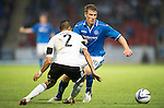 St Johnstone v Rosenborg....25.07.13  Europa League Qualifier<br /> David Wotherspoon takes on Cristian Gamboa<br /> Picture by Graeme Hart.<br /> Copyright Perthshire Picture Agency<br /> Tel: 01738 623350  Mobile: 07990 594431