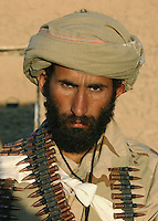 An anti-Taliban Afghan fighter poses for a photograph.
