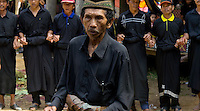 men dancing and chanting on a funeral in a traditional village in Toraja land, Sulawesi, Indonesia