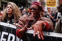 A woman takes a part during a  protest against police brutality against minorities on  04.13.2015. in New York city Kena Betancur/VIEWpress.