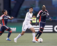 Vancouver Whitecaps FC midfielder Jun Marques Davidson (27) looks to pass as New England Revolution midfielder Lee Nguyen (24) closes. In a Major League Soccer (MLS) match, the New England Revolution defeated Vancouver Whitecaps FC, 4-1, at Gillette Stadium on May 12, 2012.