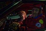 Julie Stanek and John Gurin keep warm in their car before leaving for home after the Holiday Around the World Celebration in Sun City, Az  at the Lakeview Recreation Center December 10, 2010..John's claim to fame is he got eight holes in one at Sun City's Sundial mini golf course five years ago. They met years ago at a dance in Chicago. They've lived in Sun City for 13 years...2010 marks the 50th anniversary of Sun City, America's first retirement city that remains the largest today with more than 40,000 residents 55 and older.