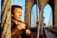 Brooklyn Bridge, New York - February 23, 1973. Jean Pierre Cassel visits the United States. He (27 October 1932 - 19 April 2007) was a French actor who was discovered by actor and director Gene Kelly, and is best known for his roles in Male Companion, by Philippe de Broca, and L' Armée des Ombres (Army of Shadows), the 1969 French film directed by Jean-Pierre Melville.
