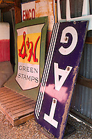 signs leaning on a wall in a garage
