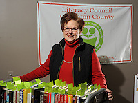 NWA Democrat-Gazette/ANDY SHUPE<br /> Sharon Nisen, a longtime volunteer with the Literacy Council of Benton County, poses Tuesday, Jan. 12, 2016, with prizes for the ninth annual Scrabble Wars, a fundraiser scheduled for Jan. 23, 2016 at the Doubletree Suites in Bentonville.