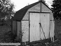 The old storage shed after years of wear.