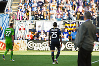 Seattle Sounders head coach Sigi Schmid watches as Seattle Sounders Lamar Neagle (27) and Sheanon Williams (25) walk to the locker room after being red carded during the second half of the Philadelphia UnionThe Philadelphia Union and the Seattle Sounders played to a 2-2 tie during a Major League Soccer (MLS) match at PPL Park in Chester, PA, on May 4, 2013.