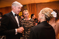 David Gregory, host of Meet the Press, and actress Charlize Theron talk to other guests at the Bloomberg Vanity Fair White House Correspondents' Association dinner afterparty at the residence of the French Ambassador on Saturday, April 28, 2012 in Washington, DC. Brendan Hoffman for the New York Times