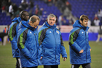 Seattle Sounders head coach Sigi Schmid with the coaching staff after the game. The New York Red Bulls defeated the Seattle Sounders 1-0 during a Major League Soccer (MLS) match at Red Bull Arena in Harrison, NJ, on March 19, 2011.