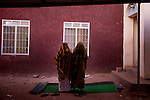 Women pray outside a mosque in the muslim neighborhood of Malikia in Juba on Jan. 6, 2011.