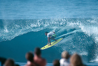 Pipeline, North Shore, Oahu, Hawaii. Ross Clarke Jones (AUS), heads into a Backdoor barrel during  the running of the 1990 Marui Pipeline Masters, Banzai Pipeline, December 7-15th 1990..Tom Carroll (AUS) won the contest with Jeff Booth (USA) in second, Ross Clarke Jones in third and Richard 'Dog' Marsh (AUS) in fourth. Photo: joliphotos.com.