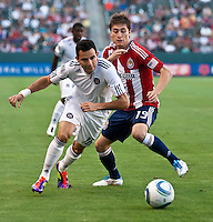 CARSON, CA – July 2, 2011: Chicago Fire midfielder Marco Pappa (16) and Chivas USA midfielder Jorge Flores (19) battle for a ball during the match between Chivas USA and Chicago Fire at the Home Depot Center in Carson, California. Final score Chivas USA 1, Chicago Fire 1.